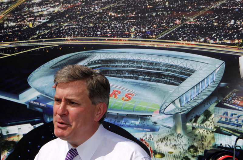 Tim Leiweke, President of Anschutz Entertainment Group, stands before an artist's conception of a proposed NFL stadium during a bill-signing ceremony by California Gov. Jerry Brown Tuesday Sept. 27, 2011, in Los Angeles. Brown signed the bill with executives from Anschutz Entertainment Group, which is proposing to build a 72,000-seat stadium next to the convention center. The bill would expedite resolution of any legal challenges to AEG's project, sending lawsuits over its environmental impact directly to the California Court of Appeal and bypassing the Superior Court.     (AP Photo/Damian Dovarganes)