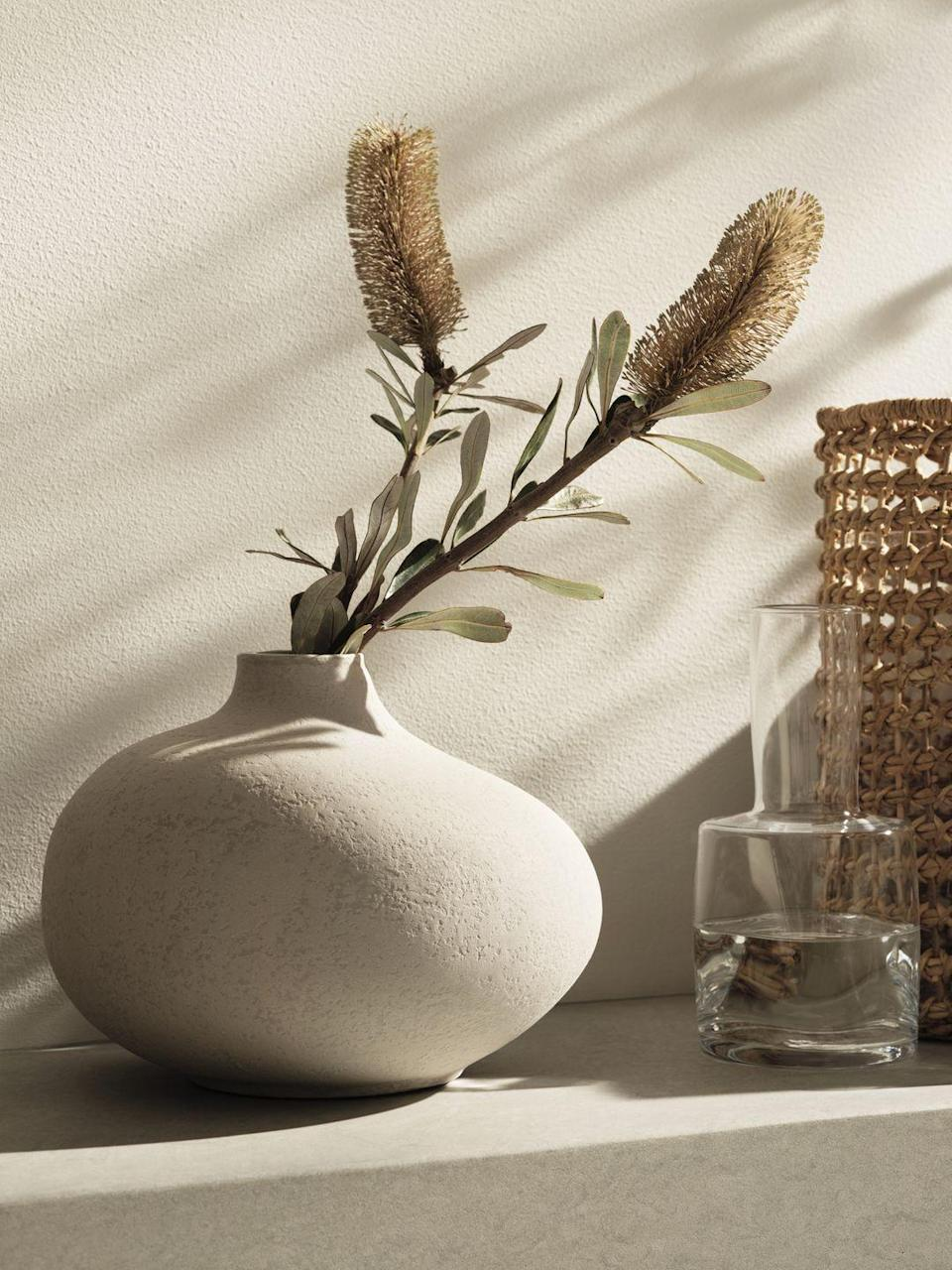 """<p>Show off your favourite blooms with this gorgeous white ceramic vase. An all-time classic, let this pretty ceramic steal the show.</p><p>'For centuries, artisans all over the world have treasured craftmanship made by hand,' say H&M Home. 'Knowledge of weaving, glassblowing, knitting and ceramics travels from generation to generation, reminding us to slow down and value the unique.'</p><p><a class=""""link rapid-noclick-resp"""" href=""""https://go.redirectingat.com?id=127X1599956&url=https%3A%2F%2Fwww2.hm.com%2Fen_gb%2Fhome.html&sref=https%3A%2F%2Fwww.housebeautiful.com%2Fuk%2Flifestyle%2Fshopping%2Fg36671419%2Fhandm-home-love-of-craft-collection-artisans%2F"""" rel=""""nofollow noopener"""" target=""""_blank"""" data-ylk=""""slk:COMING SOON"""">COMING SOON</a></p>"""