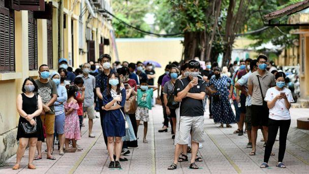 PHOTO: People observe social distancing while waiting to be tested at a makeshift rapid testing centre in Hanoi on Aug. 1, 2020, as Vietnam records a rise in cases of COVID-19. (Manan Vatsyayana/AFP via Getty Images)