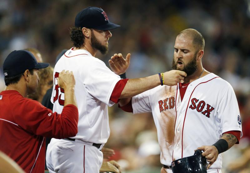 Boston Red Sox's Jarrod Saltalamacchia (39) pulls Mike Napoli's beard after Napoli scored on a double by Jonny Gomes in the third inning of a baseball game against the Chicago White Sox in Boston, Saturday, Aug. 31, 2013. (AP Photo/Michael Dwyer)