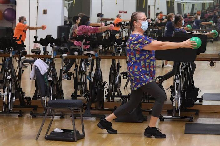 Adele Barndollar, right, works out recently during the SilverSneakers fitness classes at the Alper Jewish Community Center in Kendall.