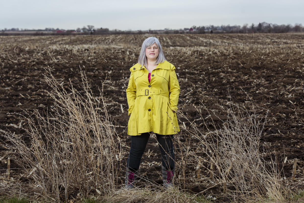 Esther Roberts stands in her friend's field in Somers, Wis., which sits directly across the road from the massive Foxconn development site in Pleasant Prarie, WIs. (Photo: Sara Stathas for Yahoo News)
