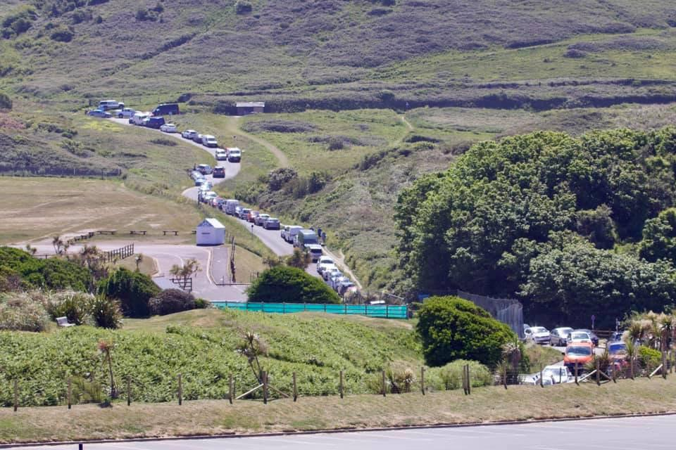 """Traffic on the approach to Woolacombe, Devon. See SWNS story SWPLbeach. Sun-seekers have been flocking to coastal hot-spots in the Westcountry in such numbers traffic wardens have reportedly run out of TICKETS. Several routes into beaches in Devon have been left clogged with traffic with roads described as """"exceptionally busy."""" Cops say several beach car parks had to be closed as people flocked to the seaside to take advantage of the hottest day of the year. Warnings had been issued urging people to stay away despite the lifting of lockdown restrictions."""
