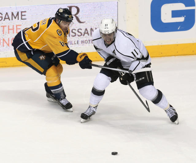 Nashville Predators forward Mike Fisher (12) tries to keep Los Angeles Kings center Anze Kopitar (11), of Slovenia, off the puck during the second period of an NHL hockey game Saturday, Dec. 28, 2013, in Nashville, Tenn. (AP Photo/Mark Humphrey)