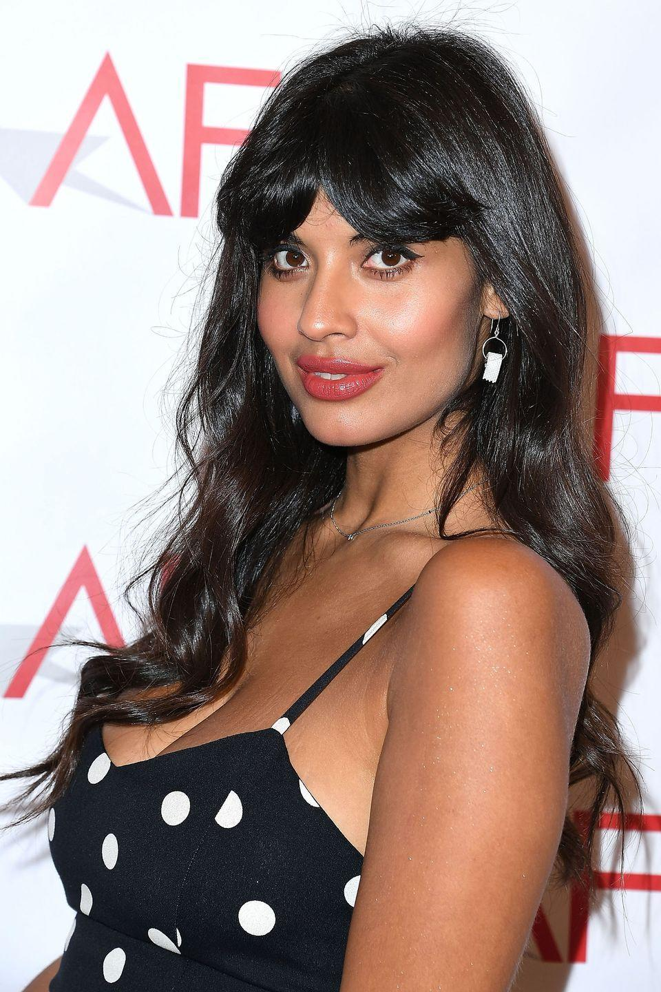 <p>Jameela Jamil's thick bangs are slightly parted in the middle, revealing a tiny bit of forehead but still allowing for that adorable blunt-bangs look.</p>