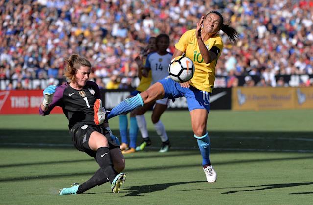 Jul 30, 2017; San Diego, CA, USA; United States goalkeeper Alyssa Naeher (1) clears a ball while pressured by Brazil forward Marta (10) during the first half at Qualcomm Stadium. Mandatory Credit: Orlando Ramirez-USA TODAY Sports TPX IMAGES OF THE DAY