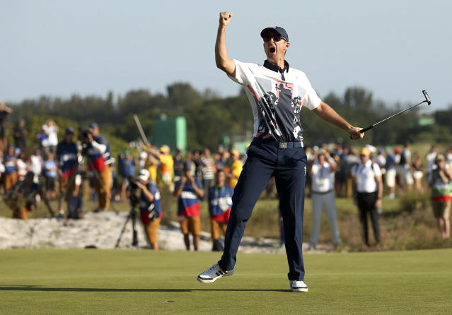 <p>Justin Rose of Britain celebrates his gold medal win in the men's Olympic golf competition at the Rio Olympics on August 14, 2016. (REUTERS/Andrew Boyers) </p>