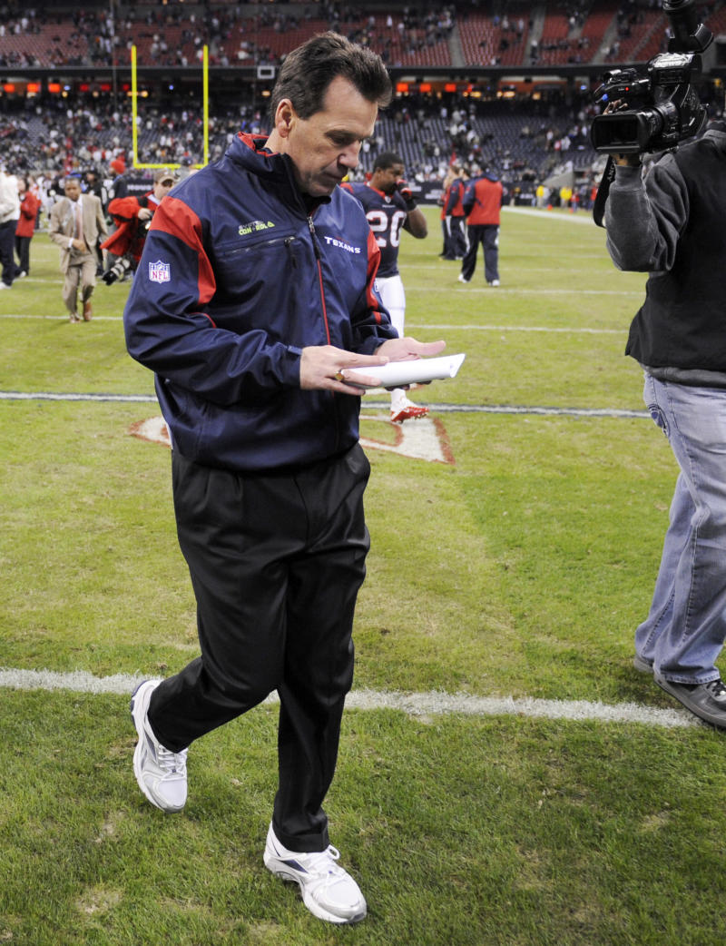 Houston Texans coach Gary Kubiak walks off the field after his team beat the Jacksonville Jaguars in an NFL football game Sunday, Jan. 2, 2011, in Houston. The Texans beat the Jaguars 34-17. (AP Photo/Dave Einsel)