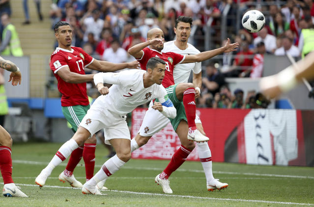 Head boy: Ronaldo nods Portugal in front against Morocco in their second Group B fixture with a thumping set piece header. (Getty)