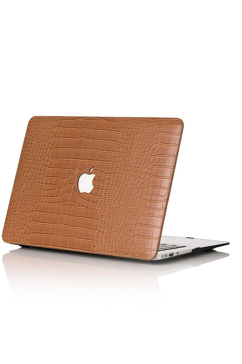 "<p><strong>Chic Geeks</strong></p><p>chicgeeks.com</p><p><strong>$95.00</strong></p><p><a href=""https://chicgeeks.com/collections/macbook-cases/products/caramel-faux-crocodile-macbook-case"" rel=""nofollow noopener"" target=""_blank"" data-ylk=""slk:Shop Now"" class=""link rapid-noclick-resp"">Shop Now</a></p><p>Help them take better care of their laptop with this faux croc case that protects electronics <em>without</em> sacrificing style.</p>"