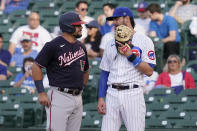 FILE - Washington Nationals' Kyle Schwarber, left, talks with former teammate, Chicago Cubs first baseman Kris Bryant, during the second inning of a baseball game in Chicago, in this May 19, 2021, file photo. Bryant's versatility, while producing offensive numbers that belong alongside his NL MVP season in 2016, is a big reason why Chicago is on top of the NL Central once again, helping the Cubs go on a 21-9 run while dealing with a rash of injuries. (AP Photo/Nam Y. Huh, File)