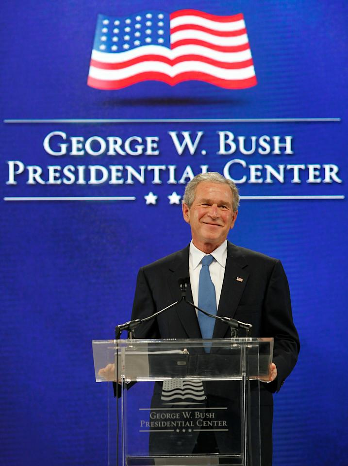 DALLAS - NOVEMBER 16:  Former U.S.  President George W. Bush addresses the audience during the George W. Bush Presidential Center groundbreaking ceremony on November 16, 2010 in Dallas, Texas. The George W. Bush Presidential Center is a state-of-the-art complex that will include former President George W. Bush's presidential library and museum, the George W. Bush Policy Institute, and the offices of the George W. Bush Foundation.  (Photo by Tom Pennington/Getty Images)