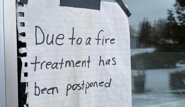 A sign remains on the door of the former Pine Lodge treatment centre in Indian Head. It has not served inpatient residents since fire and smoke caused extensive damage on Christmas Eve.