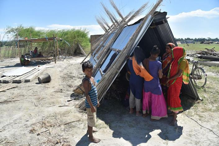 """Villagers on Sept. 27 take shelter with their belongings after their house was demolished during an eviction drive, at Gorukhuti in the Darrang district of Assam, India<span class=""""copyright"""">Anuwar Ali Hazarika/Barcroft Media via Getty Images</span>"""