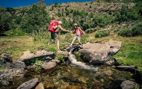 A mother and daughter trek in the mountains - Credit: aluxum/E+