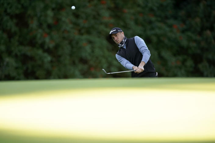 Justin Thomas chips onto the 12th green during the second round of the Genesis Invitational golf tournament at Riviera Country Club, Friday, Feb. 19, 2021, in the Pacific Palisades area of Los Angeles. (AP Photo/Ryan Kang)