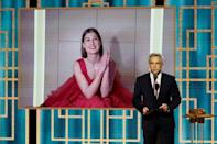 """Rosamund Pike (on screen) won the Golden Globe for best actress in a comedy film for dark thriller """"I Care A Lot"""""""
