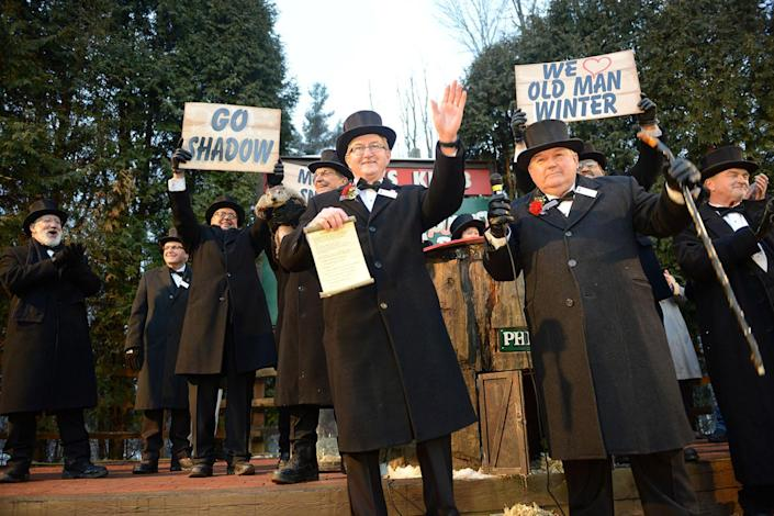 <p>Members of the Groundhog Club Inner Circle wave to the crowd after announcing Punxsutawney Phil's forecast at Gobbler's Knob on the 131st Groundhog Day in Punxsutawney, Pa., Feb. 2, 2017. (REUTERS/Alan Freed) </p>