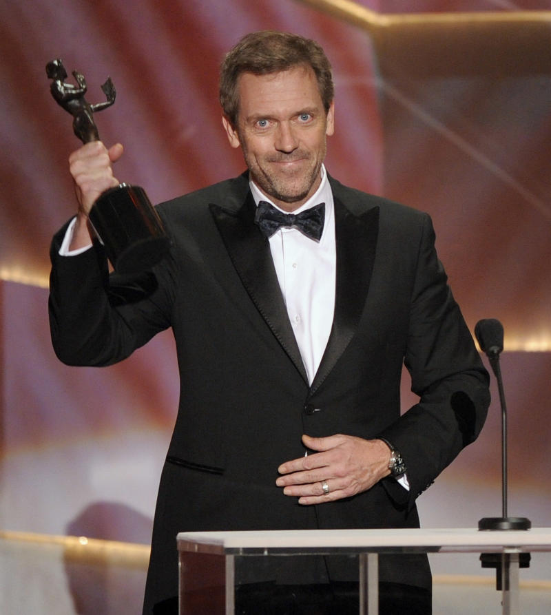 """FILE - In this Jan. 25, 2009 file photo, actor Hugh Laurie accepts the award for outstanding performance by a male actor in a drama series for """"House"""" at the 15th Annual Screen Actors Guild in Los Angeles. The Fox medical drama concludes its eight-season run on Monday, May 21, 2012, with a finale at 9 p.m. EDT, preceded by a one-hour retrospective. (AP Photo/Mark J. Terrill, file)"""