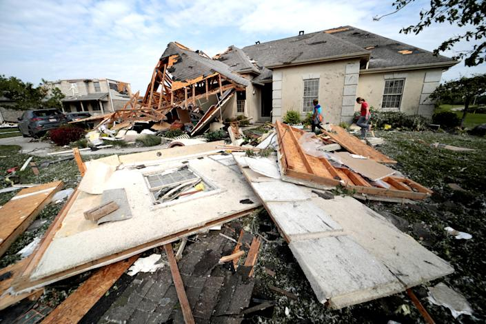 Neighbors in Clayton, Ohio gather belongings after houses were damaged after a tornado touched down overnight near Dayton, Ohio, U.S. May 28, 2019. (Photo: Kyle Grillot/Reuters)