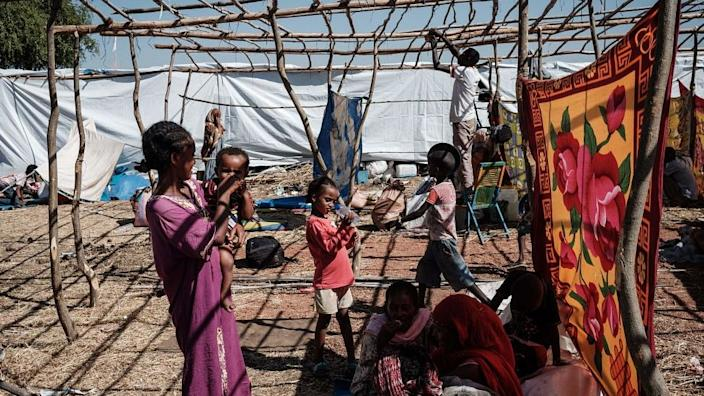Newly arrived Ethiopian refugees who fled Ethiopia's Tigray conflict rest at Um Raquba refugee camp in Gedaref, eastern Sudan, on December 9, 2020