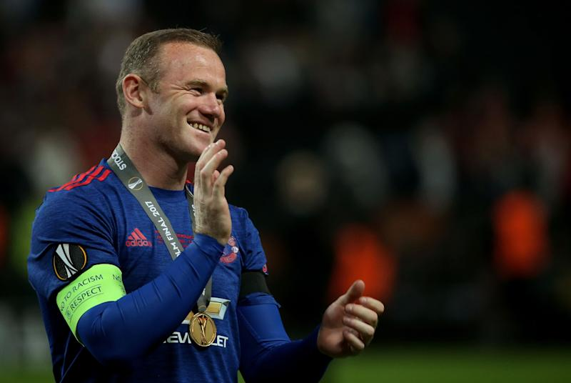 Manchester United's English striker Wayne Rooney celebrates after his team won the UEFA Europa League final football match Ajax Amsterdam v Manchester United on May 24, 2017 at the Friends Arena in Solna outside Stockholm. / AFP PHOTO / Soren Andersson (Photo credit should read SOREN ANDERSSON/AFP/Getty Images)