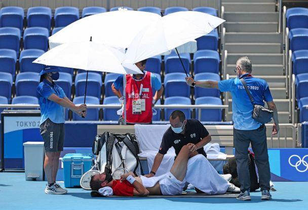 PHOTO: Daniil Medvedev of ROC (Russian Olympic Committee) gets medical treatment during men's singles third round against Fabio Fognini of Italy at Ariake Tennis Park in Tokyo on July 28, 2021. (Hiroto Sekiguchi/AP Photo)