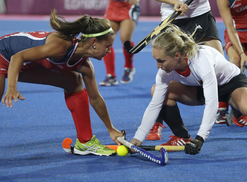 Germany's Mandy Haase, right, and United States' Paige Selenski battle for the  ball during the women's hockey preliminary match at the 2012 Summer Olympics, Sunday, July 29, 2012, in London. Germany won 2-1. (AP Photo/Bullit Marquez)
