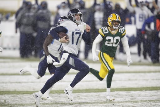 Tennessee Titans' Ryan Tannehill runs for a touchdown during the second half of an NFL football game against the Green Bay Packers Sunday, Dec. 27, 2020, in Green Bay, Wis. (AP Photo/Matt Ludtke)