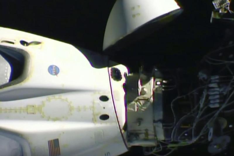 The SpaceX Crew Dragon capsule, left, before it undocked from the International Space Station (Nasa via AP)