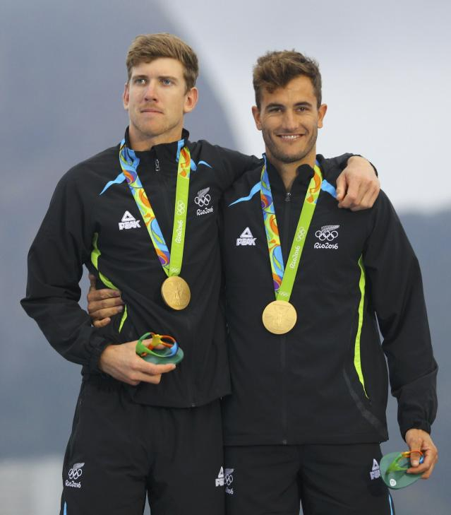 2016 Rio Olympics - Sailing - Victory Ceremony - Men's Skiff - 49er Victory Ceremony - Marina de Gloria - Rio de Janeiro, Brazil - 18/08/2016. Gold medalists Peter Burling (NZL) of New Zealand and Blair Tuke (NZL) of New Zealand pose with their medals. REUTERS/Brian Snyder FOR EDITORIAL USE ONLY. NOT FOR SALE FOR MARKETING OR ADVERTISING CAMPAIGNS.