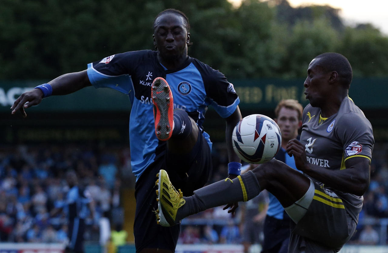 Wycombe's Marvin McCoy (left) battles contests the ball with Leicester's Lloyd Dyer (right) during the Capital One Cup, First Round match at Adams Park, Wycombe.
