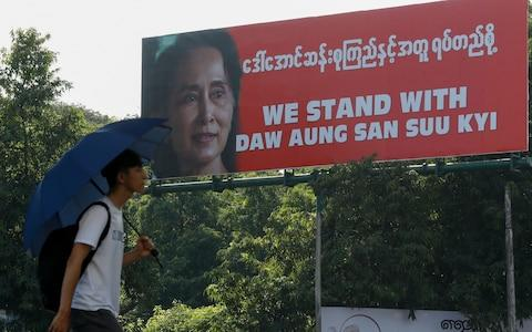 The Myanmar public have rallied to support Aung San Suu Kyi as she travels to the Hague - Credit: Lynn Bo/REX