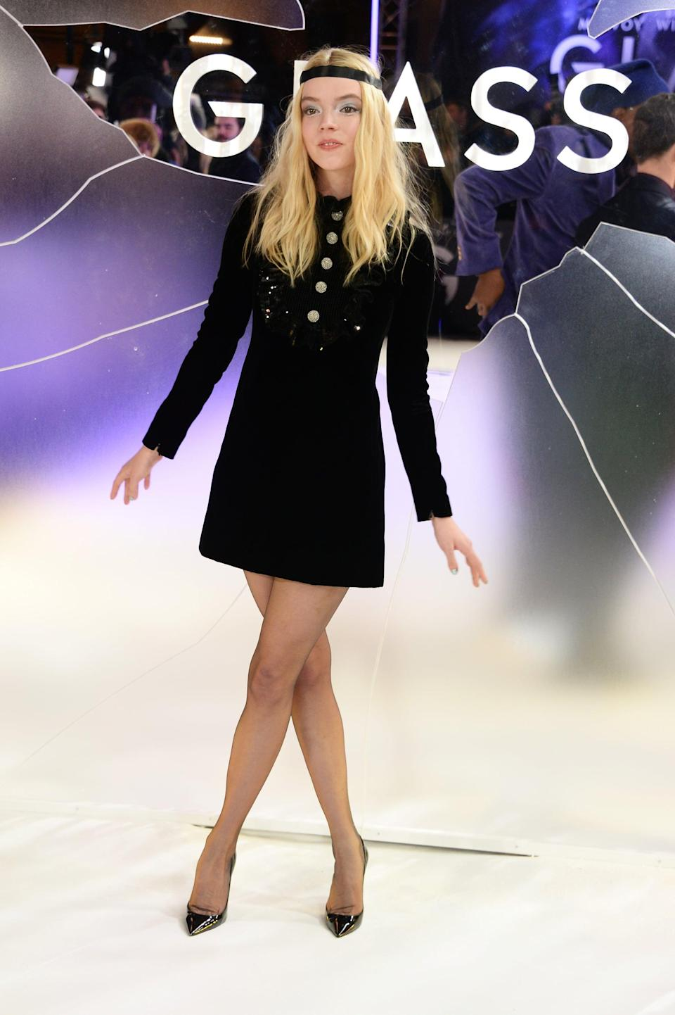 <p>Anya wore a black shirtdress teamed with YSL tights.</p>