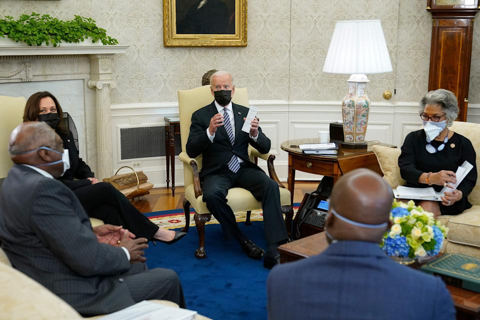 President Joe Biden speaks as he and Vice President Kamala Harris meet with members of the Congressional Black Caucus in the Oval Office of the White House, Tuesday, April 13, 2021, in Washington. Sitting are House Majority Whip James Clyburn, of S.C., from left, Sen. Raphael Warnock, D-Ga., and Rep. Joyce Beatty, D-Ohio.