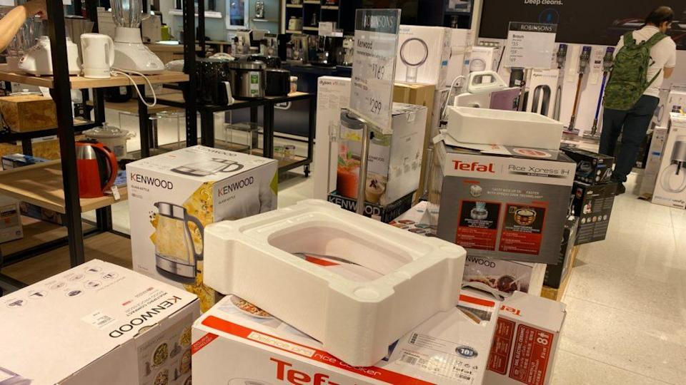Opened boxes of household items at the Raffles City outlet. Photo: Coconuts