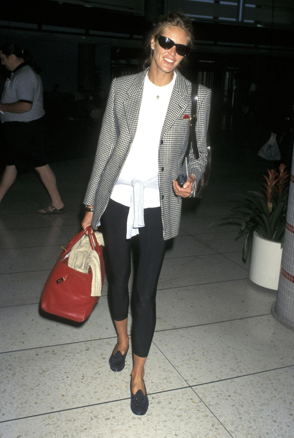<p>Catching a flight from Los Angeles, Macpherson opts for an oversized grey blazer with skin-tight jeans, 1997</p>