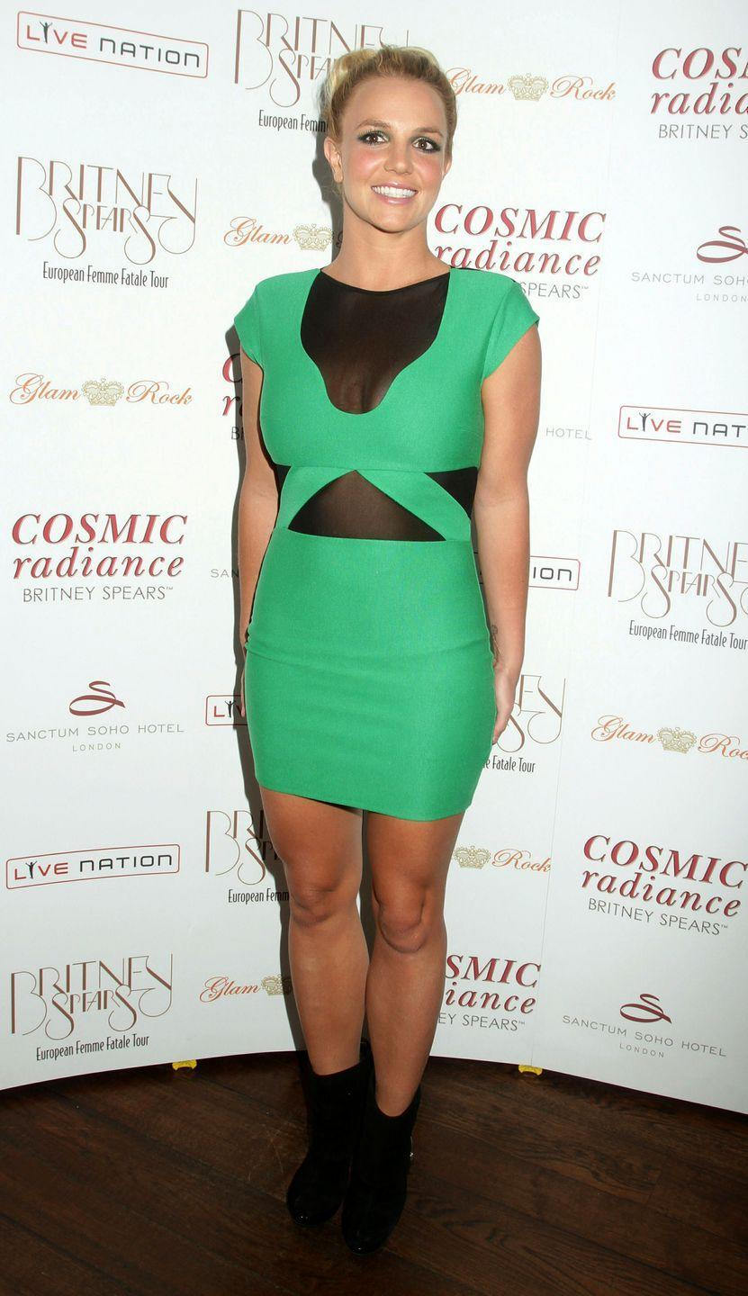 <p>Here, Britney wears an electric-green bodycon with mesh inserts and matching eyeshadow as she arrives for her UK tour launch party in London. </p>