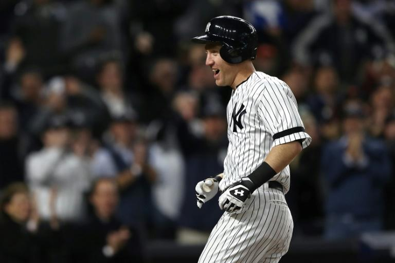 Todd Frazier of the New York Yankees celebrates hitting a 3-run home run against the Houston Astros during the second inning in Game Three of the American League Championship Series, at Yankee Stadium in New York, on October 16, 2017
