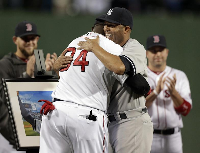 New York Yankees relief pitcher Mariano Rivera, right, hugs Boston Red Sox's David Ortiz during a tribute for Rivera before the start of a baseball game at Fenway Park, in Boston, Sunday, Sept. 15, 2013. (AP Photo/Steven Senne)