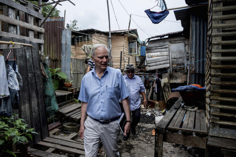 "In this hand out picture taken Friday, Aug. 16, 2019, show Philip Alston, the U.N. rapporteur on extreme poverty and human rights, visiting Kampung Numbak in Sabab, east of Malaysia. Alston said Malaysia's official poverty rate, which fell from 49 percent in 1970 to just 0.4 percent in 2016, was ""extremely artificial"" and doesn't reflect the cost of living and excluded vulnerable populations. (Bassam Khawaja via AP)"