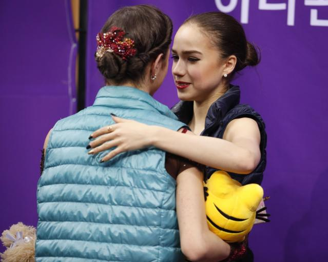 Figure Skating - Pyeongchang 2018 Winter Olympics - Women Single Skating free skating competition final - Gangneung Ice Arena - Gangneung, South Korea - February 23, 2018 - Gold medallist Alina Zagitova and silver medallist Evgenia Medvedeva, Olympic athletes from Russia, embrace after hearing their scores. REUTERS/Phil Noble