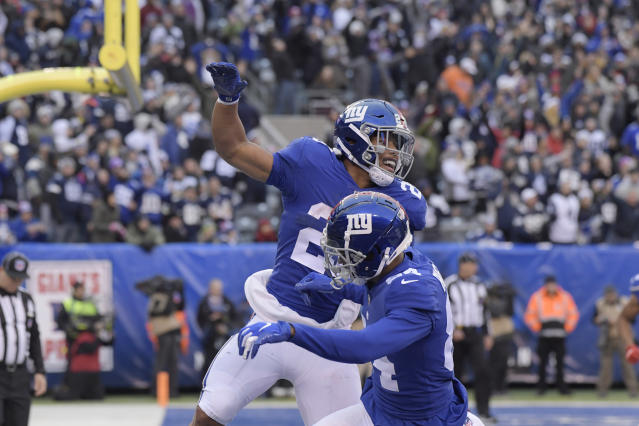 New York Giants' Saquon Barkley, top, celebrates his touchdown with teammates during the second half of an NFL football game against the Dallas Cowboys, Sunday, Dec. 30, 2018, in East Rutherford, N.J. (AP Photo/Bill Kostroun)