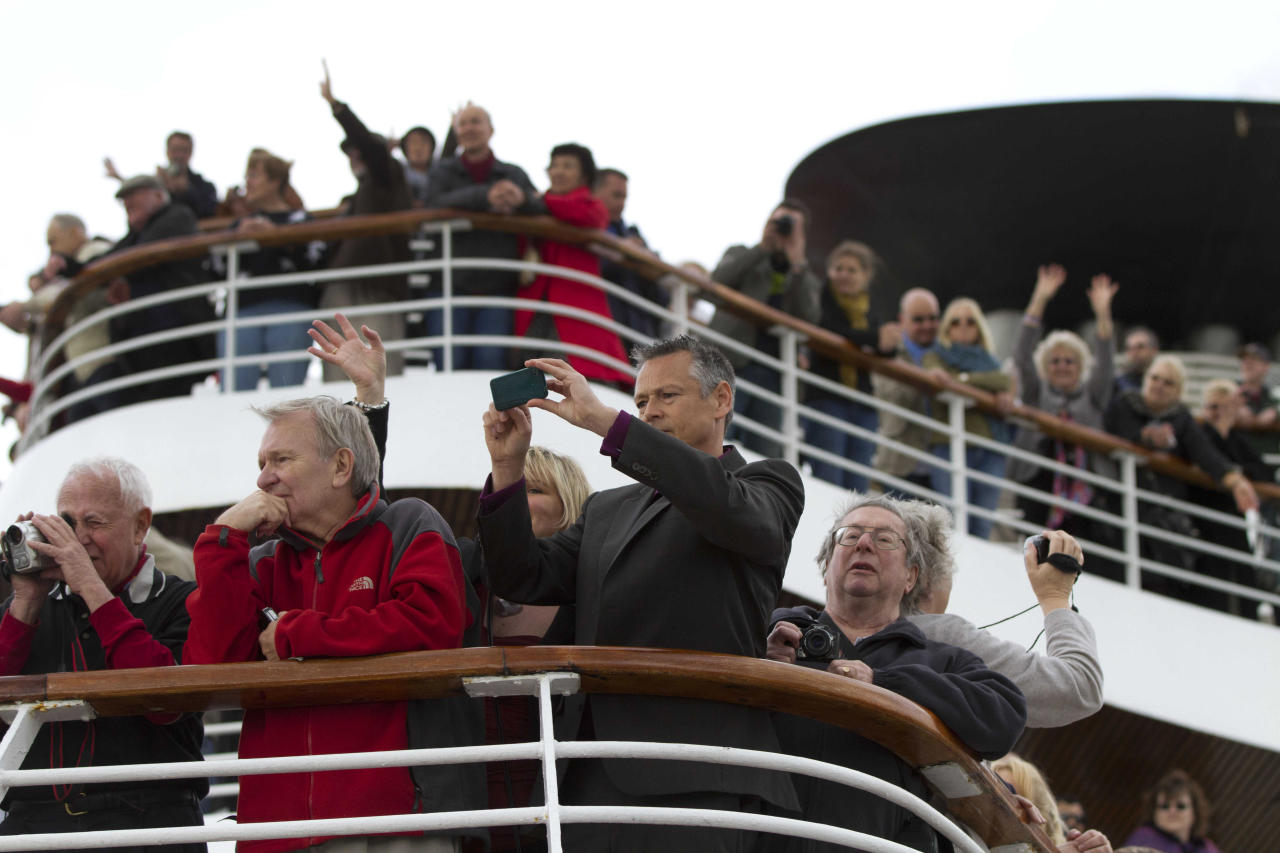 In this photo taken Sunday, April 8, 2012, passengers gather on deck as the MS Balmoral Titanic memorial cruise ship sails from Southampton, England. A cruise carrying relatives of some of the more than 1,500 people who died aboard the Titanic nearly 100 years ago set sail from England on Sunday to retrace the ship's voyage, including a visit to the location where it sank (AP Photo/Lefteris Pitarakis)