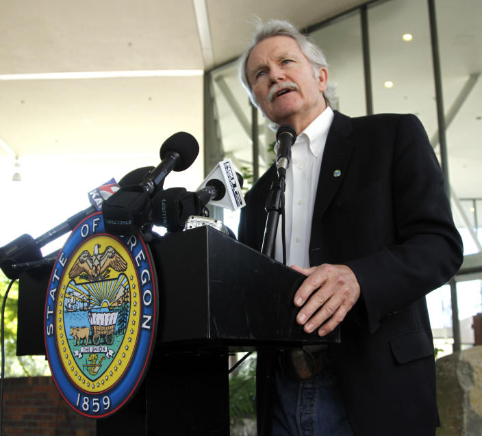 FILE - In this July 1, 2011, file photo, Oregon Gov. John Kitzhaber talks after signing two health care bills in Portland, Ore. The Obama administration is buying into Oregon's ambitious health care initiative, announcing Thursday that it's tentatively agreed to chip in $1.9 billion over five years to help get the program off the ground. The federal government could save $1.5 trillion over the next 10 years if all 50 states adopted Oregon's approach, the governor said. (AP Photo/Don Ryan, file)