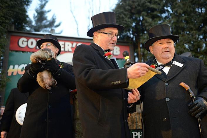 <p>Inner Circle member Jeff Lundy reads Phil's forecast at Gobbler's Knob on the 131st Groundhog Day in Punxsutawney, Pa., Feb. 2, 2017. (REUTERS/Alan Freed) </p>