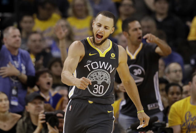 Golden State Warriors guard Stephen Curry (30) celebrates after scoring against the Houston Rockets during the second half of Game 4 of the NBA basketball Western Conference Finals in Oakland, Calif., Tuesday, May 22, 2018. (AP Photo/Marcio Jose Sanchez)