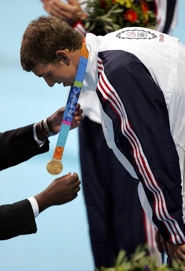 Michael Phelps of the United States wins the Men's 100m Butterfly gold medal at the Olympic Aquatic Centre in Athens Greece on August 20, 2004. Phelps set a new olympic record time of 51.25 seconds. (Photo by Allen Kee/WireImage)