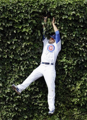 Chicago Cubs center fielder David DeJesus catches a fly ball hit by Houston Astros' Brian Bixler during the sixth inning of a baseball game in Chicago, Friday, June 29, 2012. (AP Photo/Nam Y. Huh)