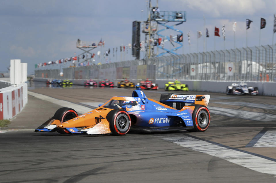 Scott Dixon leads a pack into Turn 1 during an IndyCar auto race Sunday, Oct. 25, 2020, in St. Petersburg, Fla. (AP Photo/Mike Carlson)